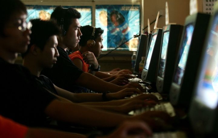 Chinese young people use computers at an Internet cafe in Beijing on Saturday, June 16, 2005.