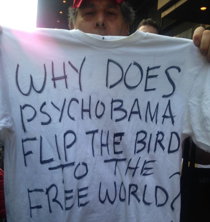 Protester Michael Fandal holds up a T-shirt he made.