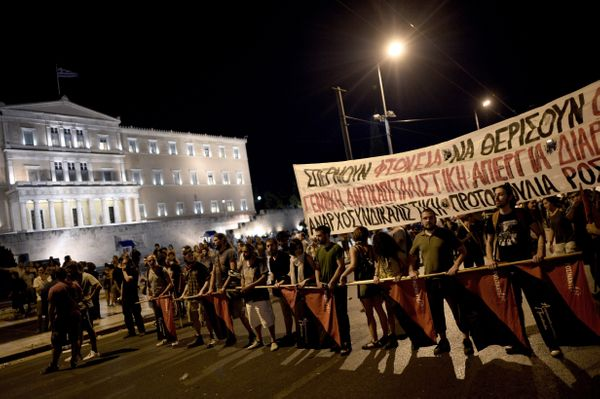 Protesters demonstrate outside the Greek Parliament in Athens on July 22, 2015.