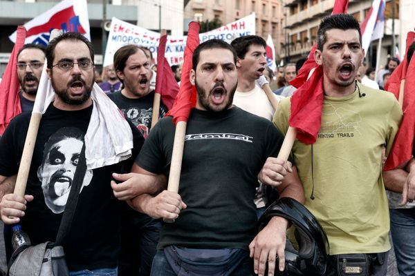 Anti-austerity demonstrators shout slogans in front of the Greek Parliament in Athens on July 22, 2015.