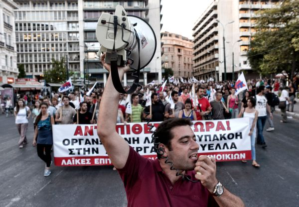 Anti-austerity demonstrators gather in front of the Greek Parliament in Athens on July 22, 2015.