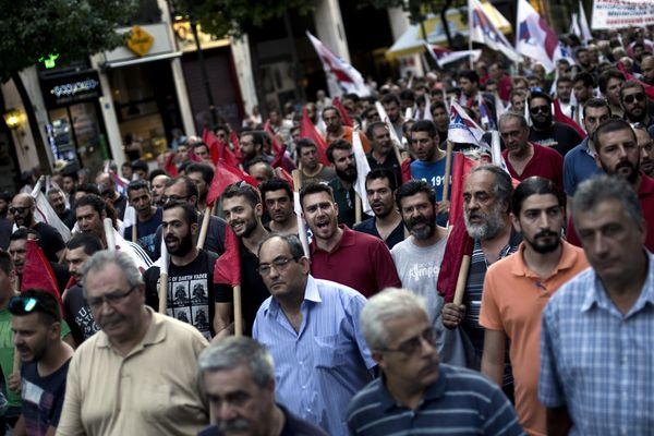 Members of the Communist-affiliated trade union PAME shout slogans during an anti-austerity demonstration in Athens, Greece,
