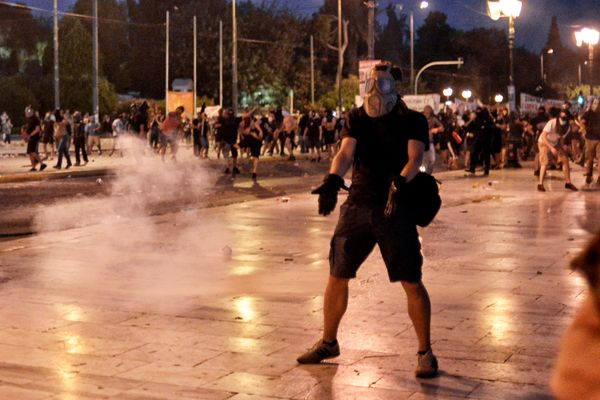 A protester gestures during an anti-austerity protest in Athens, Greece, on July 15, 2015.