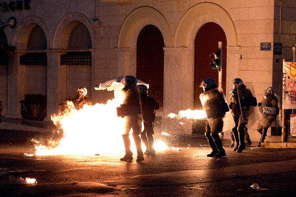 Protesters clash with riot police in front of the Greek Parliament in Athens on July 15, 2015.