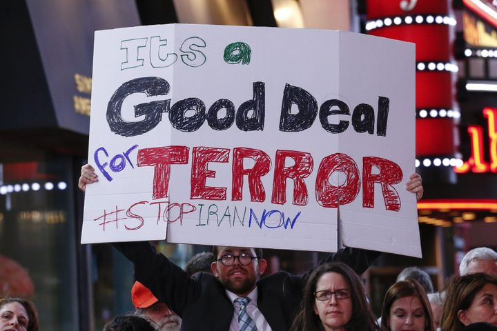 A protester holds a sign at the rally.