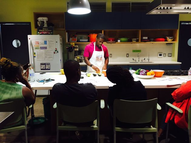 Participants look on while a community volunteer conducts a cooking class as part of Oldways' African Heritage and Health program.