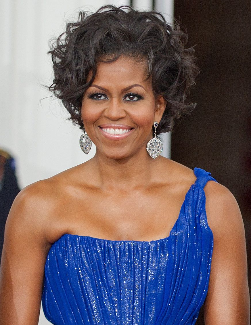 US First Lady Michelle Obama is seen during the arrival of the Mexican President and Mexican First Lady May 19, 2010 on the North Portico at the State Dinner for Mexico at the White House in Washington, DC.     AFP Photo/Paul J. Richards (Photo credit should read PAUL J. RICHARDS/AFP/Getty Images)