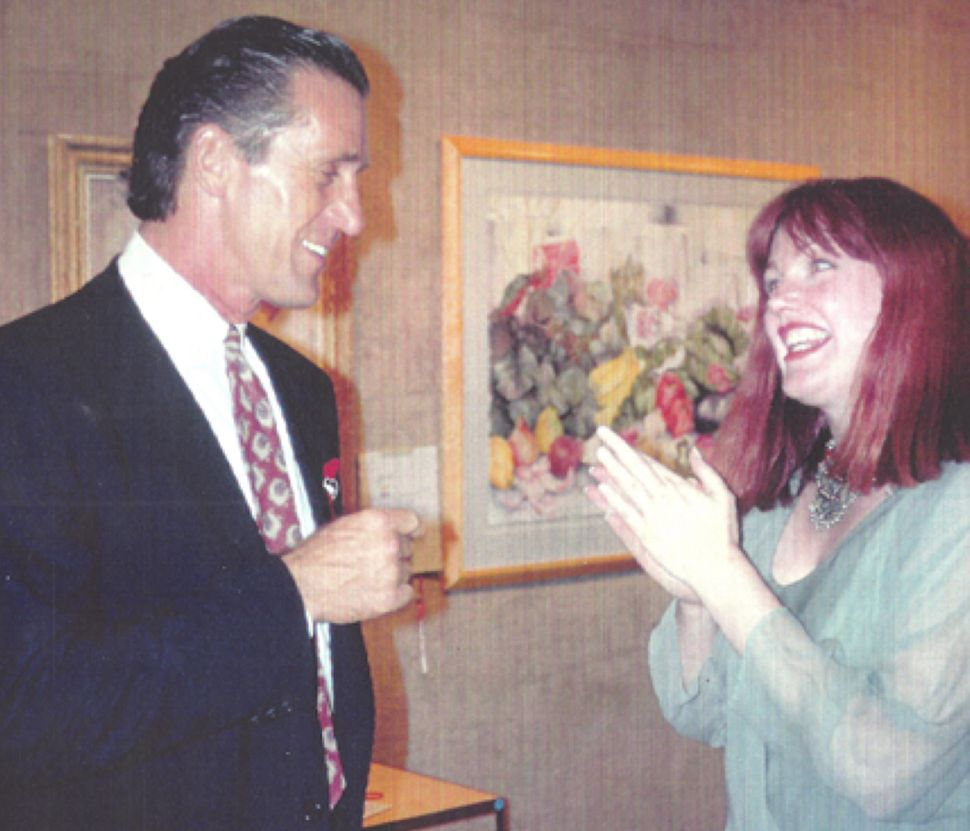 Monica Lynch (right) with Knicks coach Pat Riley circa 1994.