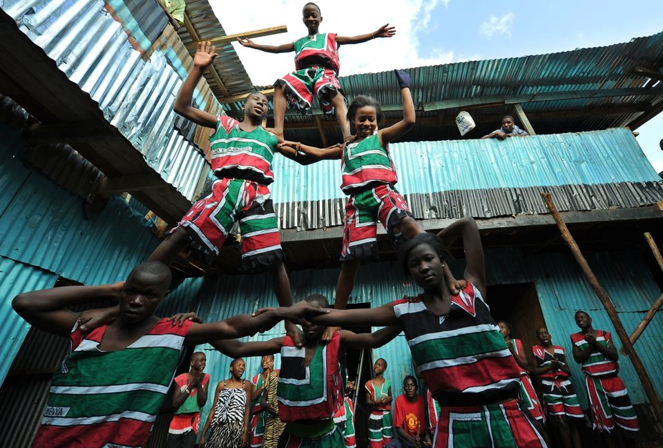 Youth corps members demonstrate their skills at the Kibera slum in Nairobi, Kenya, on July 28, 2014.