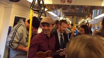 Subway Commuters Unite For Heartwarming Sing-Along