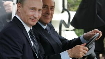 PORTO ROTONDO, ITALY - APRIL 18:  Outgoing Russian President Vladimir Putin and Italian Prime Minister-elect Silvio Berlusconi (R) drive an electric buggy as they arrive to attend a joint press conference at Berlusconi's private summer residence villa 'La Certosa' on April 18, 2008 in Porto Rotondo, near Olbia, Italy. The meeting focused on developing bilateral relations with discussions on energy and the Italian Alitalia airline on the agenda.  (Photo by Artyom Korotayev/Epsilon/Getty Images)