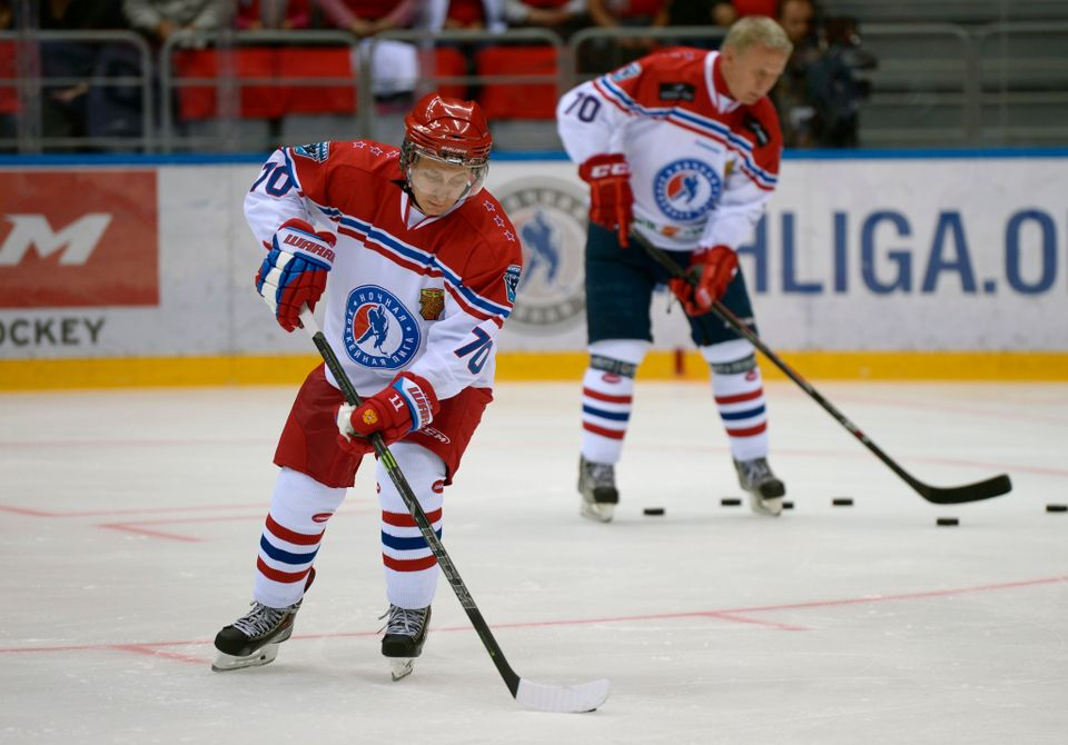Russian President Vladimir Putin warms up before a game at the Night Hockey League tournament at Sochi, Russia, on May 16, 20