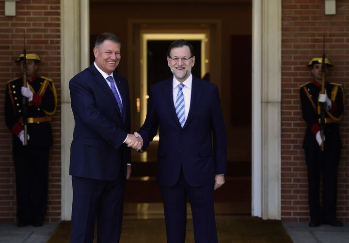 Spanish Prime Minister Mariano Rajoy, right, shakes hands with Romanian President Klaus Iohannis prior to a meeting at La Mon