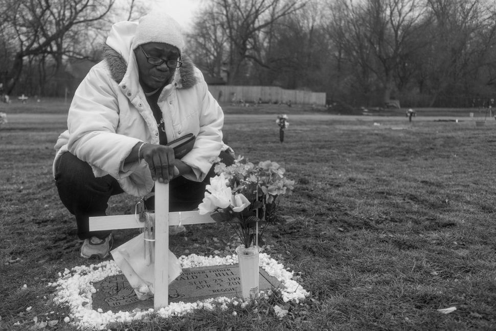 Rain or shine, Brenda visits the grave of her son every Sunday after church.