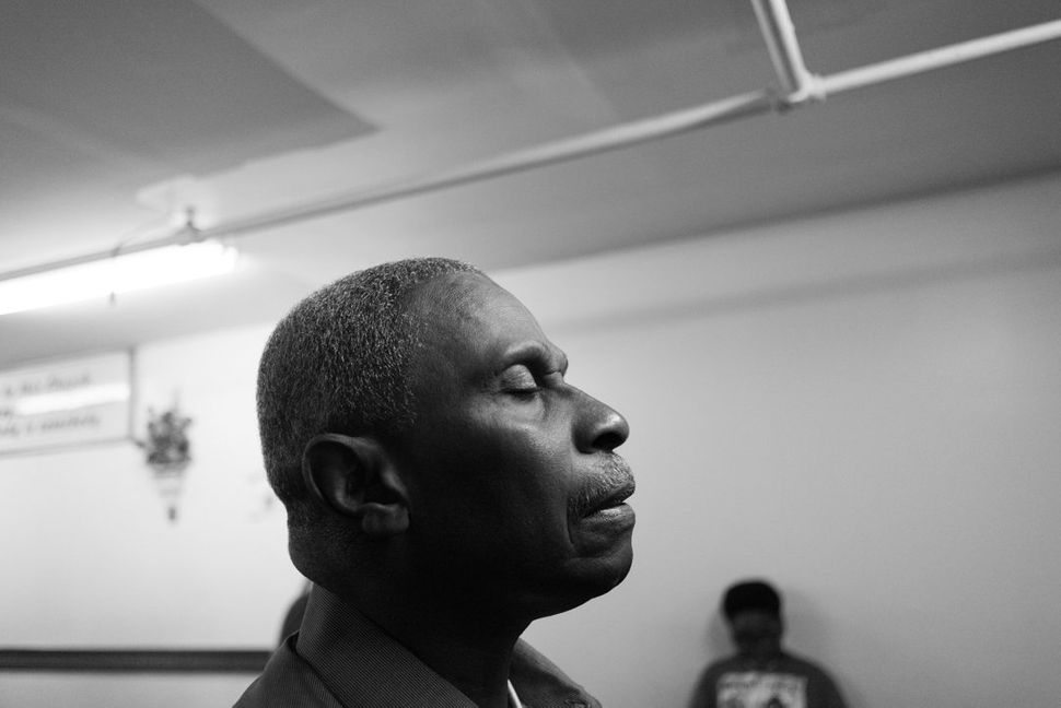 Herman gets comfort for his PTSD at his storefront church in Harlem. They are the rare moments of peace that he has sinc