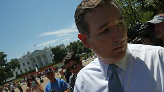 WASHINGTON, DC - JULY 23:  Republican presidential candidate, U.S. Sen. Ted Cruz (R-TX) walks past the White House after speaking at a rally in Lafayette Square July 23, 2015 in Washington, DC. The rally, organized by the Concerned Women for America Legislative Action Committee, was held to protest the recent nuclear deal reached between the United States and Iran but was interrupted by protesters from Code Pink who support the deal.  (Photo by Win McNamee/Getty Images)