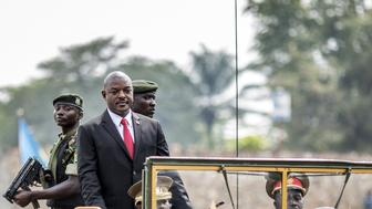 Burundi's President Pierre Nkurunziza (2nd L) arrives in a car for celebrations of the country's 53rd Independence Anniversary at Prince Rwagasore Stadium in Bujumbura on July 1, 2015. Six people including a policeman were killed in gun battles on July 1 in the latest violence in Burundi, as it awaits results from elections boycotted by the opposition and condemned internationally. Elsewhere in the capital, military parades were held to mark the country's independence day. AFP PHOTO / MARCO LONGARI        (Photo credit should read MARCO LONGARI/AFP/Getty Images)