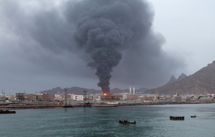 <span>Fire and smoke rises from the Aden oil refinery following a reported shelling attack by Houthi rebels in the embattled
