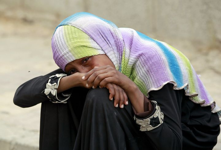 <span>A Yemeni woman cries over the death of relatives in a reported airstrike by the Saudi-led coalition on the capital Sana