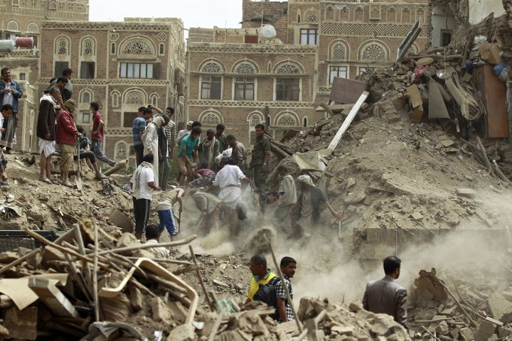 <span>Yemenis search for survivors under the rubble of houses in the UNESCO-listed heritage site in the old city of Yemeni ca