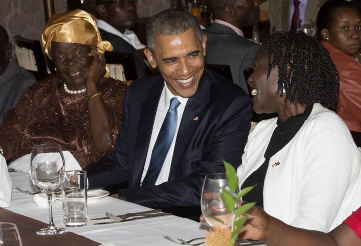 President Barack Obama sits alongside his step-grandmother, Mama Sarah (L) and half-sister Auma Obama (R), during a gathering