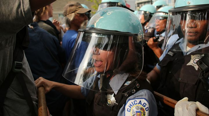 """<p><span style=""""color: #000000; font-family: Verdana, Arial, Helvetica, sans-serif; font-size: 11px; background-color: #ffffff;"""">Protesters and Chicago Police confront each other near the NATO conference venue on the first day of the NATO summit on May 20, 2012 in Chicago.</span></p>"""