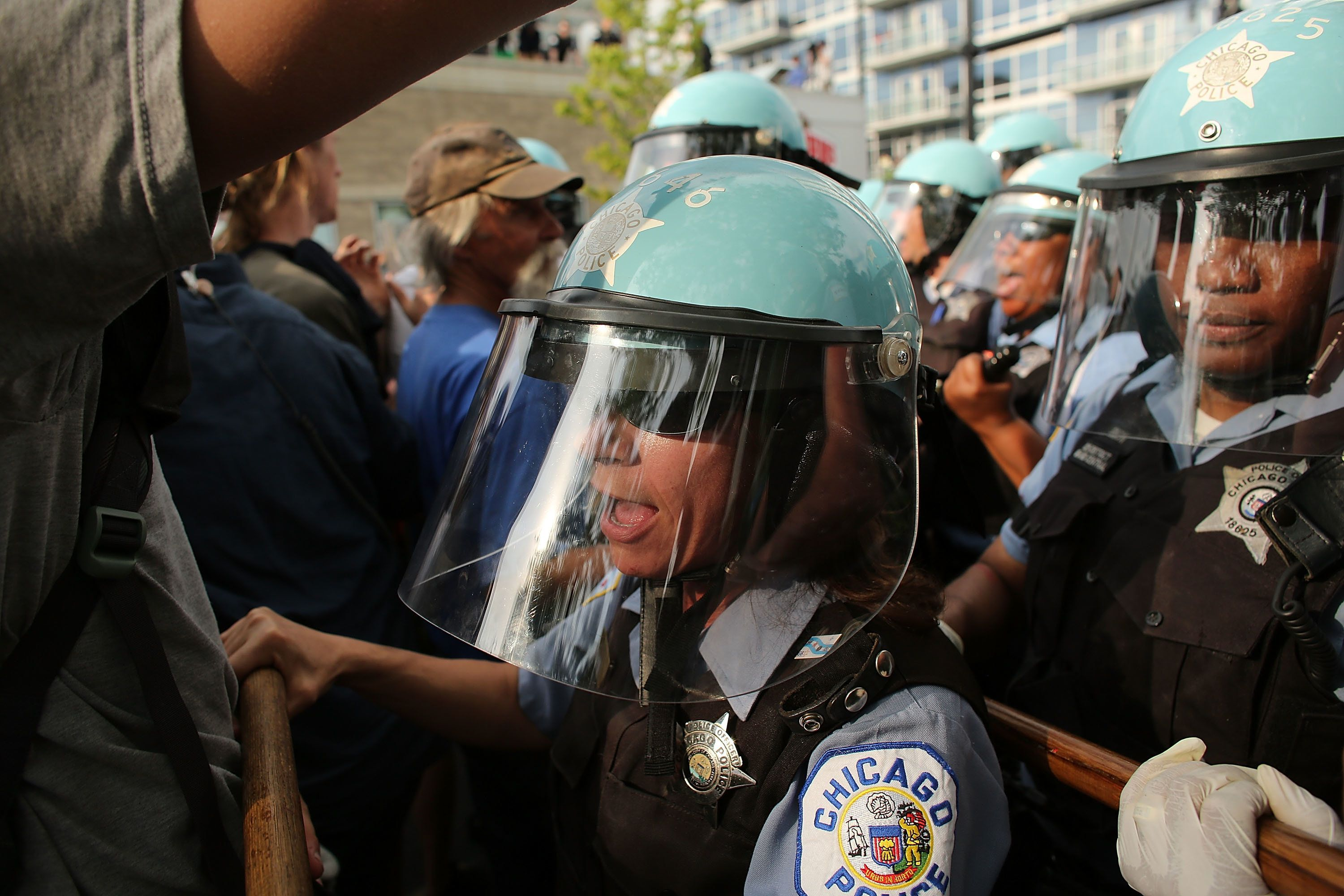 <span>Protesters and Chicago Police confront each other near the NATO conference venue on the first day of the NATO summit on