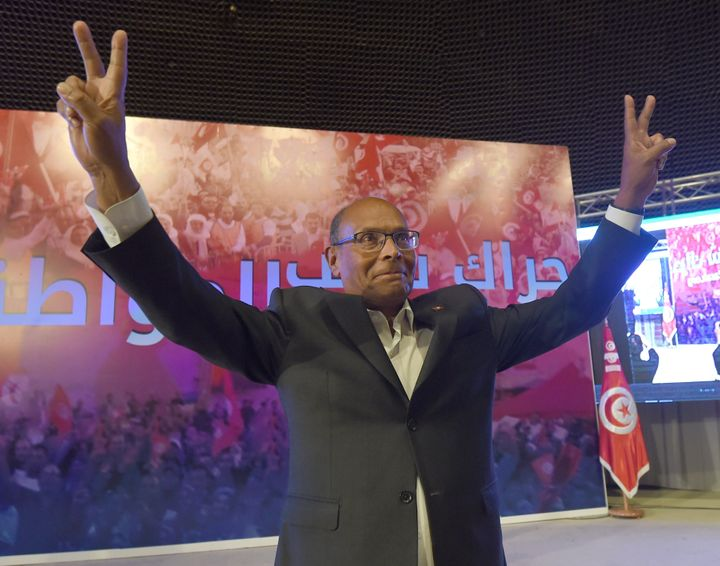 Former Tunisian President Moncef Marzouki flashes the sign for victory during a preparatory congress ahead of launching his n