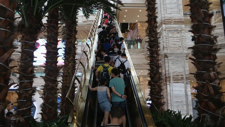 People ride up an escalator at the New Century Global Center on June 30, 2015, in Chengdu, China.