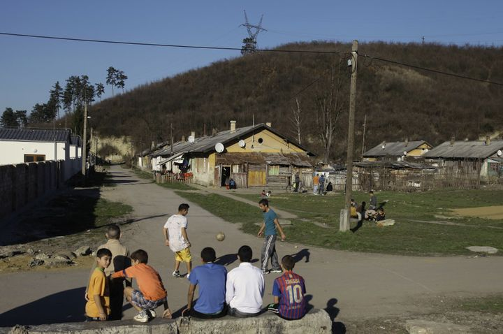 <span>Roma children play ball in Ozd, northern Hungary on March 14, 2014.</span>