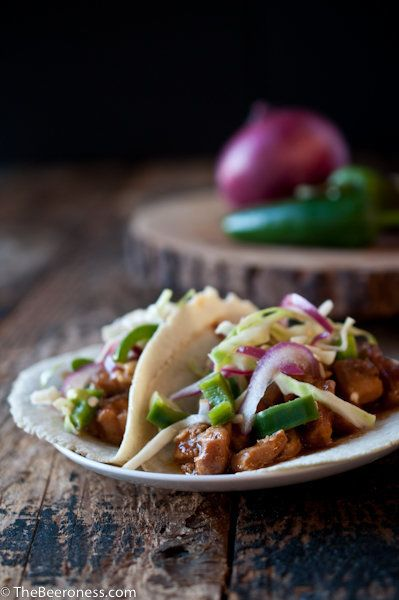 "<strong>Get the <a href=""http://thebeeroness.com/2014/01/24/slow-cooker-beer-chicken-tacos-jalapeno-slaw/"" target=""_blank"">Sl"