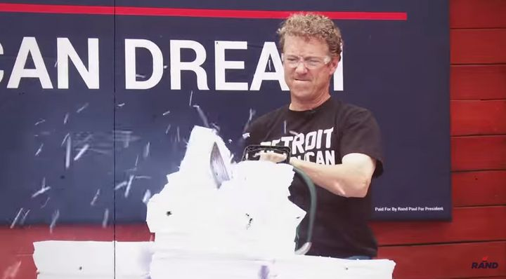 Sen. Rand Paul (R-Ky.) went at a copy of the U.S. tax code with a chain saw, fire and a wood-chipper.