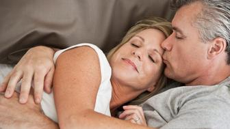 BHBAXG Middle-aged couple cuddling in bed