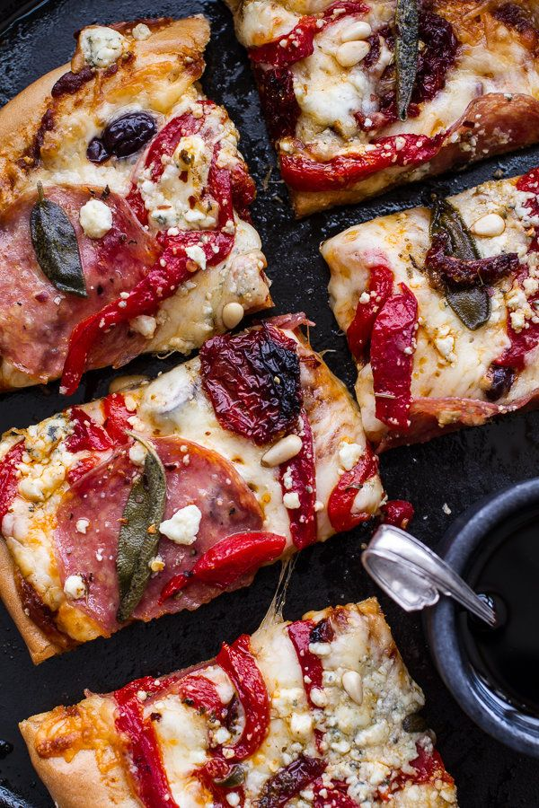 """<strong>Get the <a href=""""http://www.halfbakedharvest.com/sun-dried-tomato-olive-pesto-pizza-salami-roasted-red-peppers/"""" targ"""