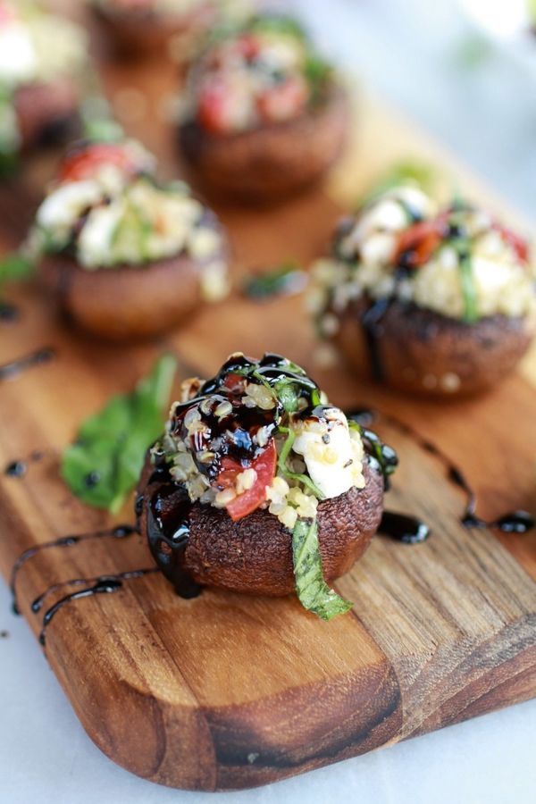 "<strong>Get the <a href=""http://www.halfbakedharvest.com/caprese-quinoa-grilled-stuffed-mushrooms-with-balsamic-glaze/"" targe"
