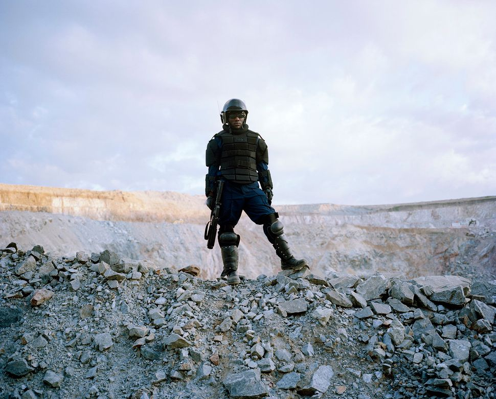 Mine security at the North Mara mine in Tanzania. On average, 800 villagers and migrants enter the North Mara mine illegally