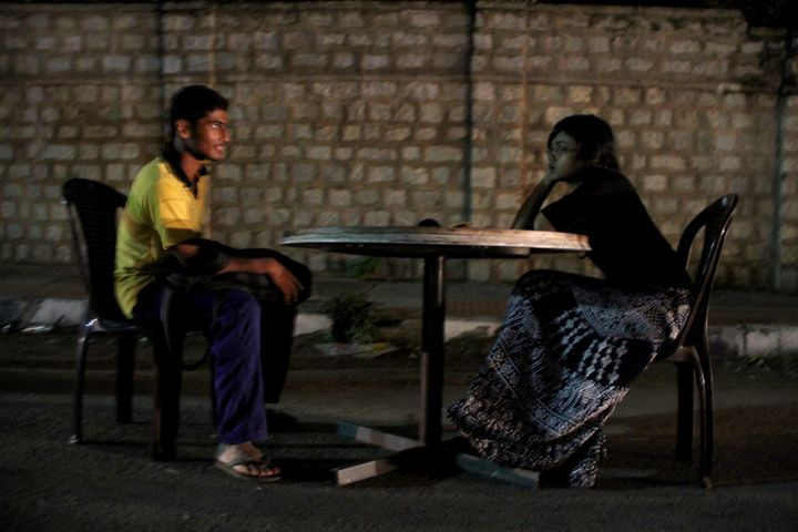 """<em>An activist converses with a stranger on a road near Bangalore, India, as part of the award-winning public art project, """""""