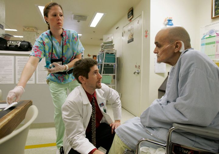 "<p><span style=""font-family: Arial, Helvetica, sans-serif; font-size: 14px; line-height: 20px; background-color: #eeeeee;"">Dr. Joseph Bick, center, talks to Hepatitis C patient Richard Carreiro, as nurse Laura Escareno-Scarrott, watches in the hospice of the California Medical Facility in Vacaville, Calif., Jan. 17, 2007. Bick, as chief medical office at the prison facility, sees many inmates with the deadly disease. (AP Photo/Marcio Jose Sanchez)</span></p>"