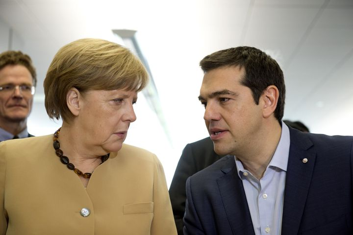 German Chancellor Angela Merkel (L) and Greek Prime Minister Alexis Tsipras (R) speak during negotiations over Greece's new b