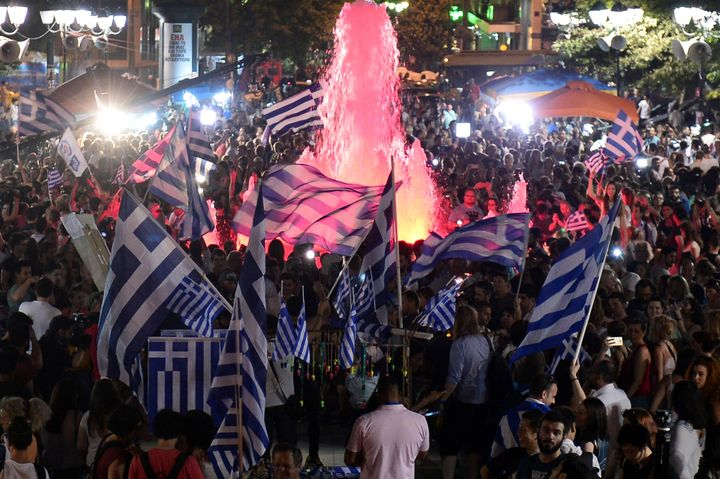 "Greek citizens celebrate the victory for the ""no"" vote in Greece's July 5 referendum on a new bailout deal from Greece's cred"
