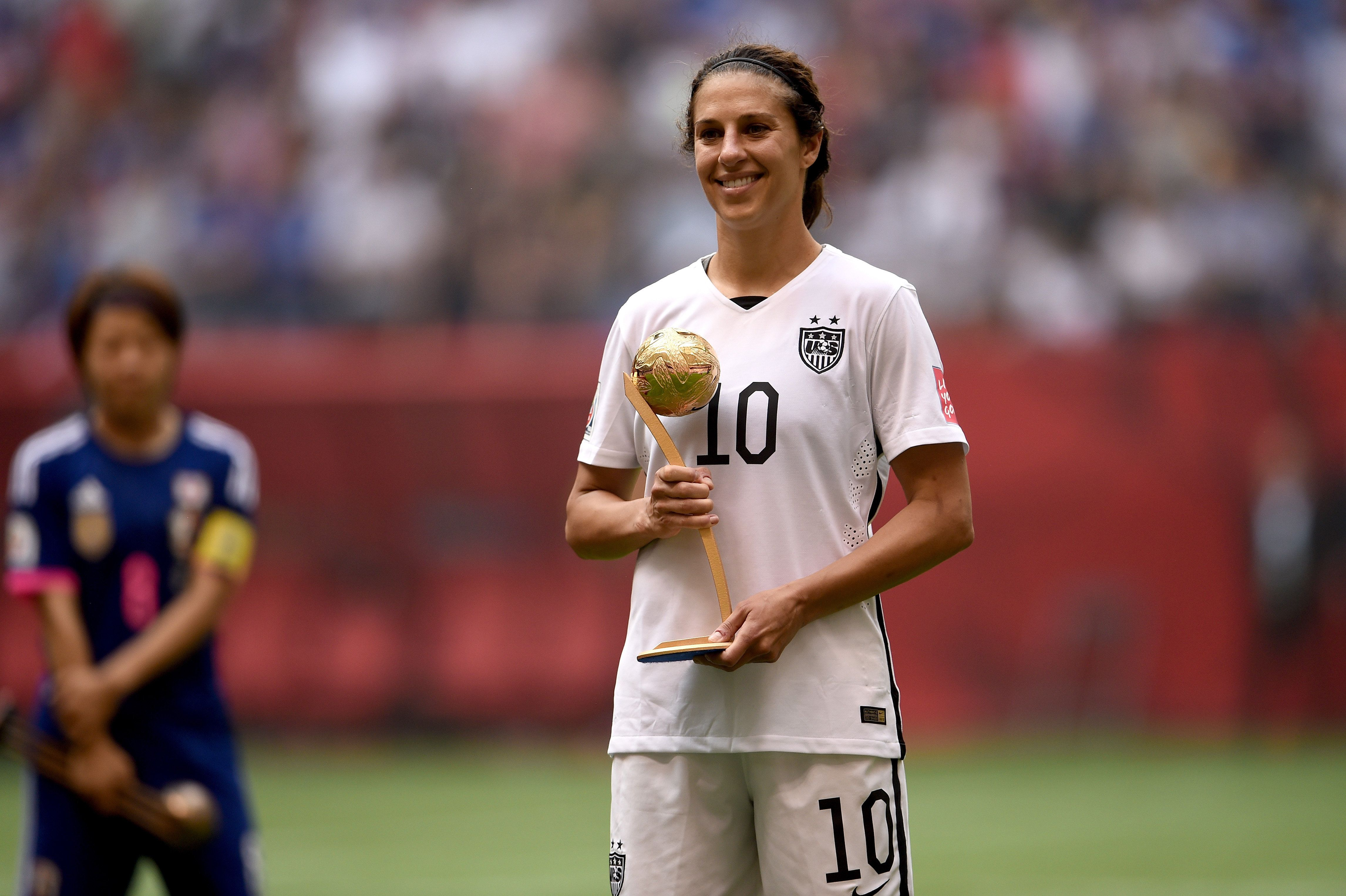 VANCOUVER, BC - JULY 05:  Carli Lloyd #10 of the United States poses after winning the Golden Ball during the FIFA Women's World Cup Canada 2015 Final at BC Place Stadium on July 5, 2015 in Vancouver, Canada.  (Photo by Dennis Grombkowski/Getty Images)