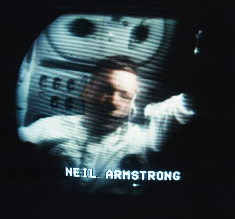 Kinescope images of astronaut Commander Neil Armstrong in the Apollo 11 space shuttle during the space mission to land on the