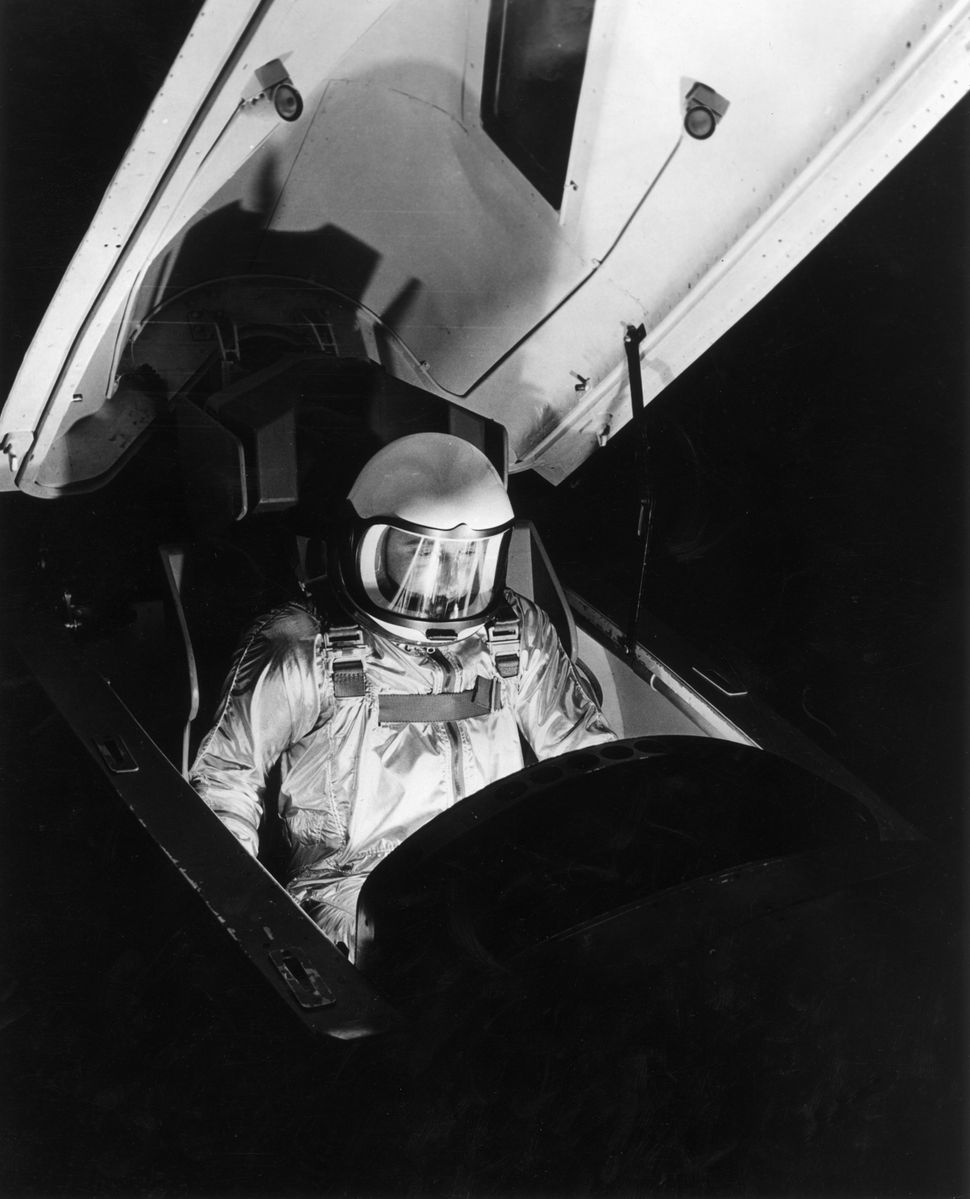 A military pilot sits in the cockpit of an X-15 experimental rocket aircraft, wearing an astronaut's spacesuit circa 1959.  (