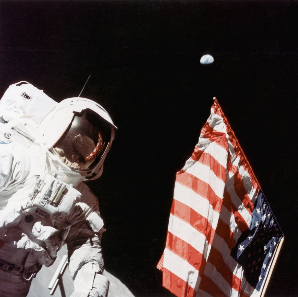 American geologist and Apollo 17 astronaut Harrison Hagan Schmitt stands next to the U.S. flag on the surface of the moon&nbs