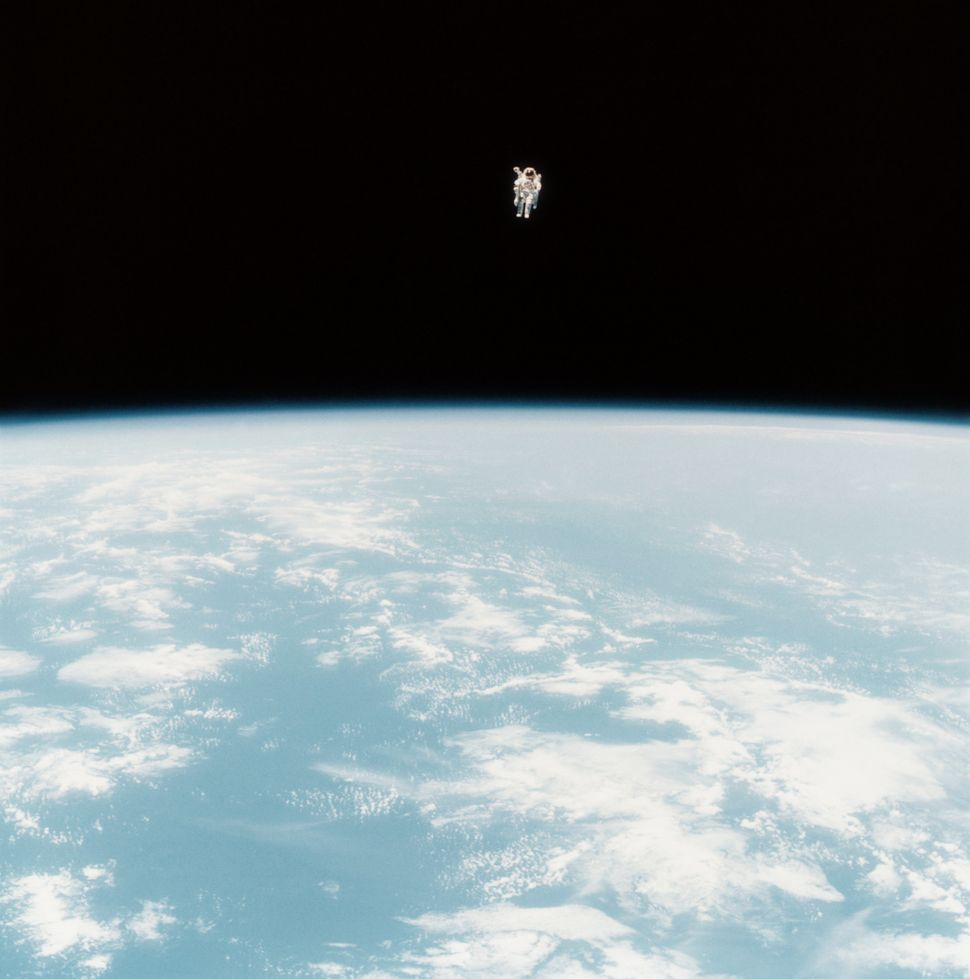 Astronaut Bruce McCandless II photographed at his maximum distance (320 feet) from the Space Shuttle Challenger during the fi