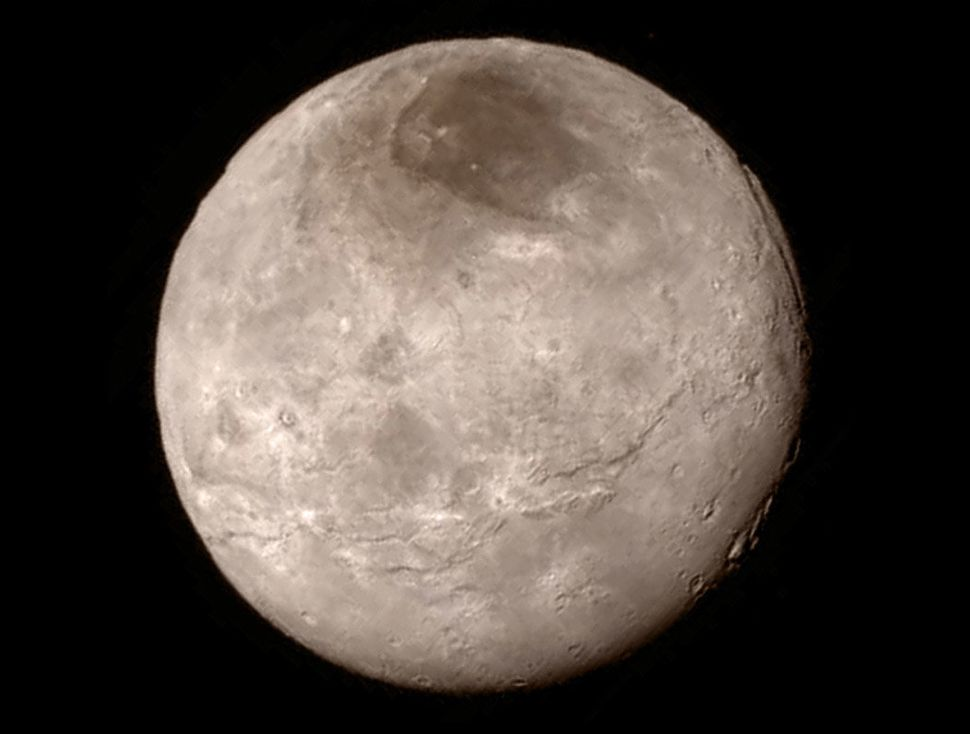 Pluto's largest moon Charon is shown from a distance of 289,000 miles from the Long Range Reconnaissance Imager aboard NASA's