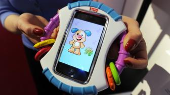 The Laugh & Learn Baby iCan Play Case by Fisher-Price which protects an iPhone while a baby can play with apps stored on the device on display at the Toy Fair 2011 on February 15, 2011 at the Javits Center in New York. AFP PHOTO/Stan HONDA (Photo credit should read STAN HONDA/AFP/Getty Images)