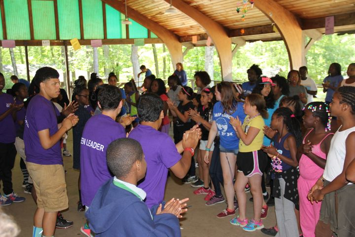 Campers sing a lunchtime song.