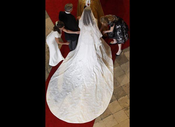 Kate having her dress adjusted.   (AFP photo)