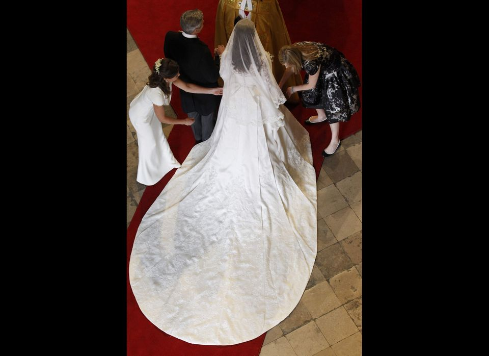 Kate having her dress adjusted. 